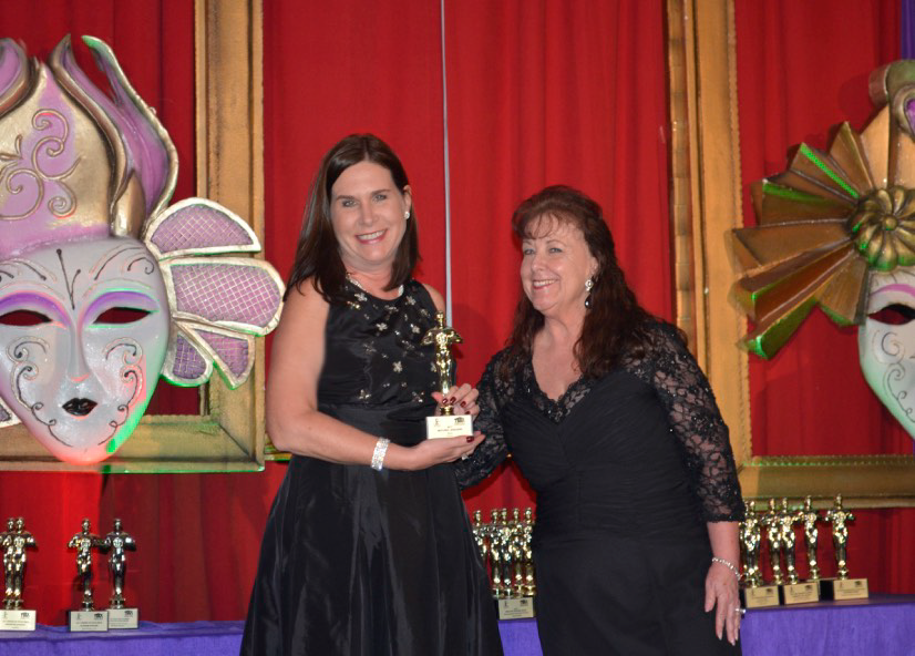 Asturia Wins Two Awards at TBBA's Masquerade Ball